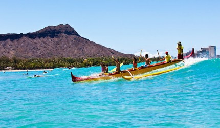 Canoe surfers at Waikiki beach with Diamond Head in the background.  Photo courtesy of Hawaii Tourism Authority (HTA) / Tor Johnson.