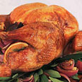 Roast Turkey with Oranges, Bay Leaves, Red Onions, and Pan Gravy