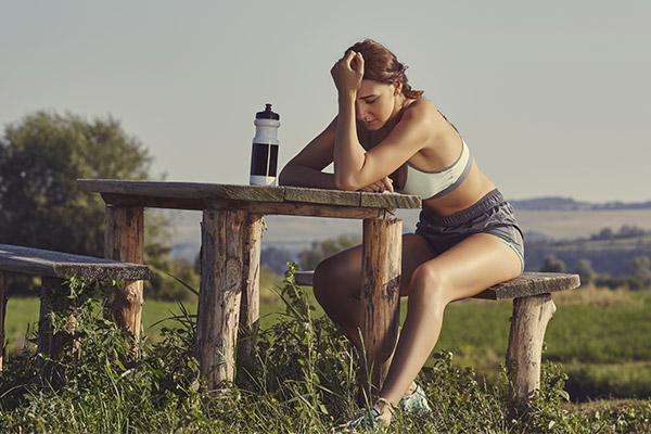 Photo of tired runner resting