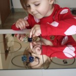 Number Bubbles: A Number Recognition and Counting Game on Mirrors