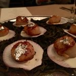 """Okay, so we didn't actually eat dirt. But, the ingredients and presentation were all designed to mimic the elements of """"terroir."""" Here, scallops are dusted with juniper, flaked with silver-leaf, on a bed of elderberry cream. This was paired with Authentique Chardonnay."""