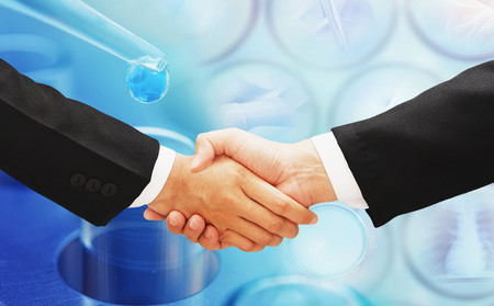 business hand shake with lab backgroud