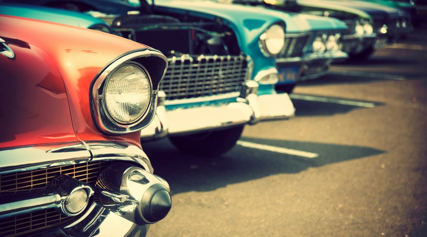 A line of classic antique cars