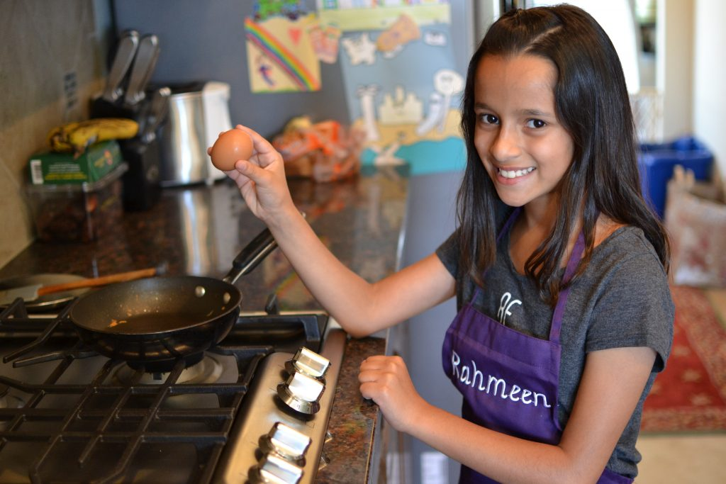 rahmeen-malik-10 child chef cooking eggs