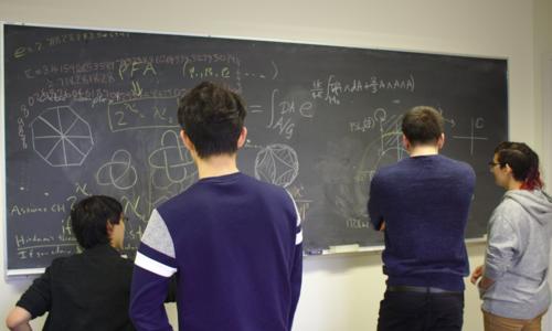 Students Working at Blackboard
