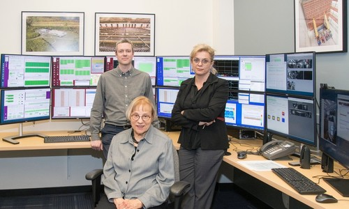 The heart of the Charles Peck Remote Operations Center.  Pictured from left: Ryan Patterson (head of Caltech NOvA group), Kathleen Peck, Maria Spiropulu (Caltech HEP PI).