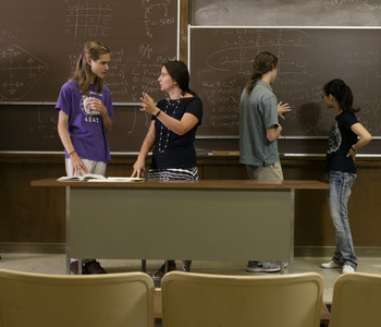 Students and Instructor Working at the Blackboard