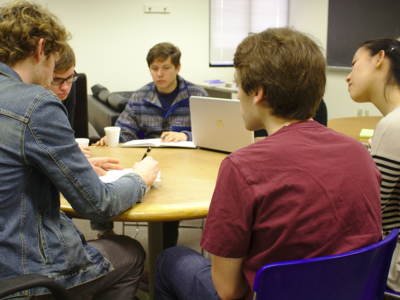 Photo of Student Collaborating Around a Table