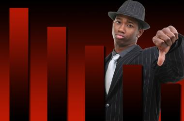 Businessman With Thumb Down Over Falling Graph Background. Red and black graph.