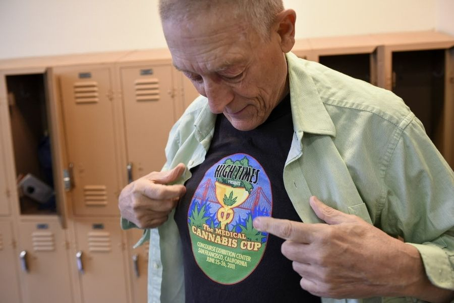 Michael Koehn shows of his High Times t-shirt as he gets dressed following a swim with his husband David Goldman, at the Rossi Pool in San Francisco, CA, on Wednesday March 15, 2017. David and his husband Michael Koehn swim three times a week at the pool. PHOTO: Michael Short
