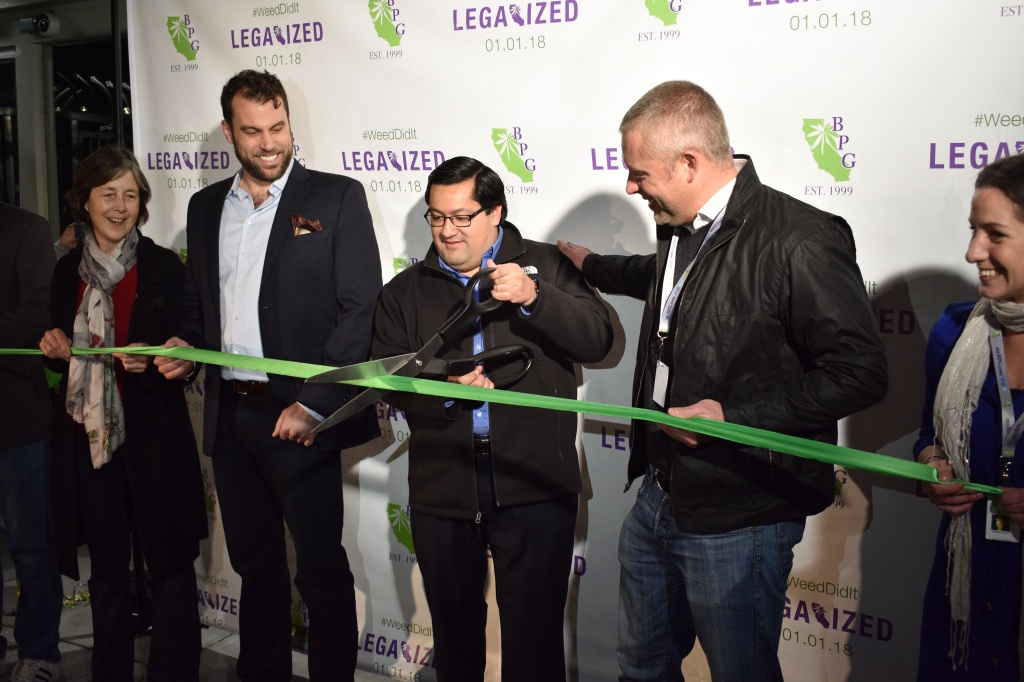 Berkeley Mayor Jesse Arreguin cuts the ribbon on Berkeley Patients Group's legal sales of recreational marijuana at 6 am on Jan. 1.