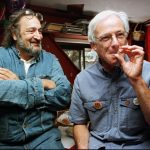 FILE - In this Nov. 6, 1996 file photo, Dennis Peron, leader of the campaign for Proposition 215 and founder of the Cannabis Buyers Club, right, smokes a marijuana cigarette next to Jack Herer, of Los Angeles, in San Francisco. Peron, an activist who was among the first people to argue for the benefits of marijuana for AIDS patients and helped legalize medical pot in California, died Saturday, Jan. 27, 2018, at 72. Peron was a driving force behind a San Francisco ordinance allowing medical marijuana — a move that later aided the 1996 passage of Proposition 215 that legalized medical use in the entire state. (AP Photo/Andy Kuno, File)