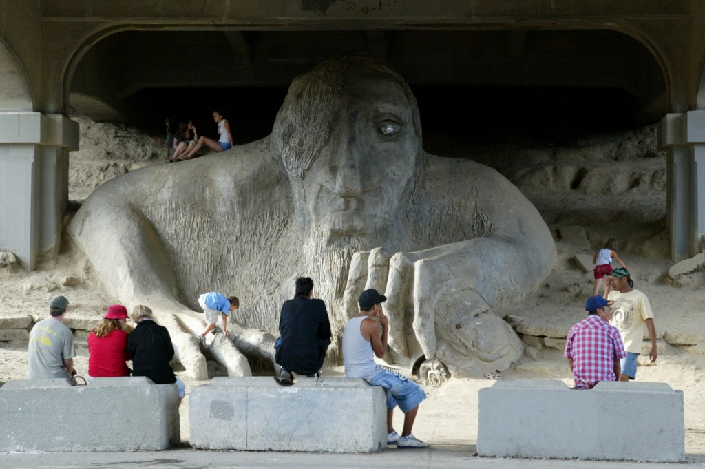 Visitors check out the Fremont Troll under the Aurora Bridge in Fremont on Friday July 6, 2007. Photo by Joshua Trujillo / Seattle Post-Intelligencer