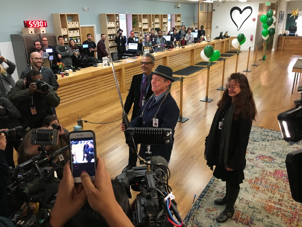 Harborside founder Steve DeAngelo cuts the ribbon at 6 am in Oakland to kick off California's legal recreational sales of marijuana on New Year's Day.