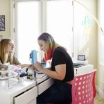 Christina Blea, right, gives a cannabis-themed manicure to writer Emily Earlenbaugh, in her Dabulous Nail Bar at her home in Richmond, Calif., on Wednesday January 31, 2018.
