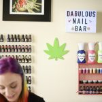 Nail polish and a pot leaf sign hang on the wall at Christina Blea's Dabulous Nail Bar, at her home in Richmond, Calif., on Wednesday January 31, 2018.