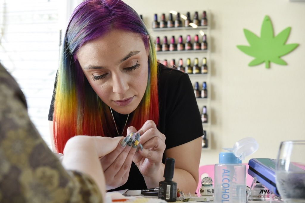 Christina Blea, right, gives a Cannabis themed manicure to writer Emily Earlenbaugh, in her Dabulous Nail Bar at her home in Richmond, Calif., on Wednesday January 31, 2018.