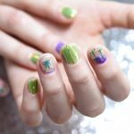 Writer Emily Earlenbaugh shows off her Cannabis themed manicure given to her by Christina Blea at her Dabulous Nail Bar, in her home in Richmond, Calif., on Wednesday January 31, 2018.