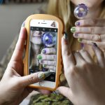 Christina Blea, left, takes pictures of the finished cannabis-themed manicure given to writer Emily Earlenbaugh, in Christina's Dabulous Nail Bar, at her home in Richmond, Calif., on Wednesday January 31, 2018.