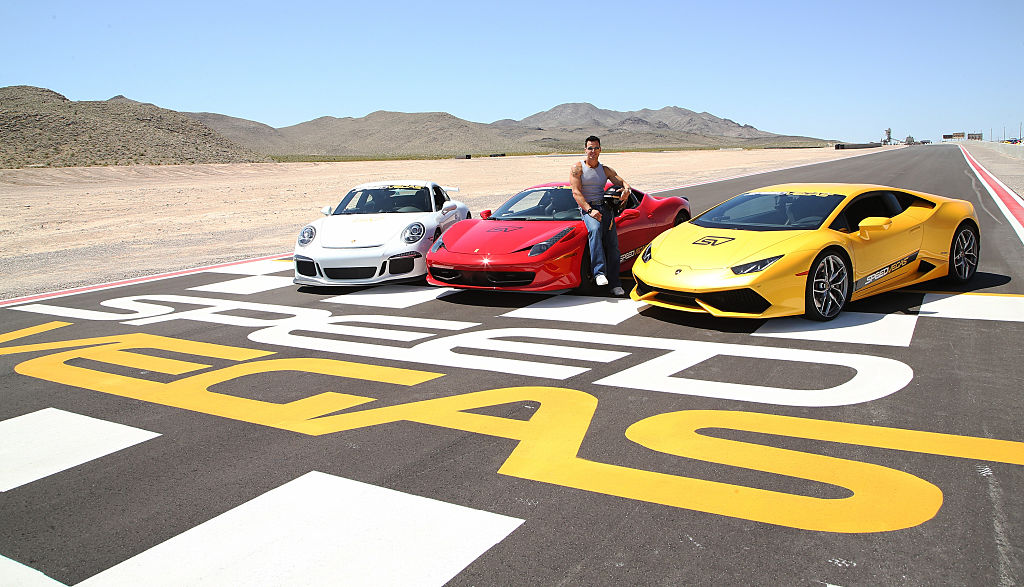 Actor/model Antonio Sabato Jr. poses with a 2015 Porsche 911 GT3, a 2013 Ferrari 458 Italia and a 2015 Lamborghini Huracan at the SpeedVegas motorsports complex on May 30, 2016 in Las Vegas. | Photo: Getty
