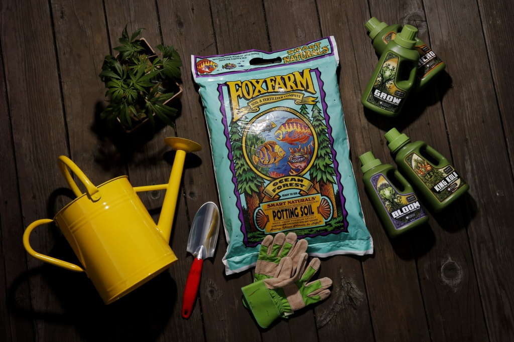 From clockwise: A bag of potting soil, nutrient jugs, gardening gloves, trowel, watering can and clones in pots, Wednesday, Feb. 14, 2018, in San Francisco, Calif. | Photo by Santiago Mejia