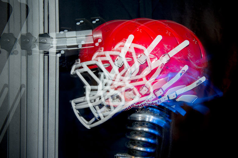 What is a good question for a research paper about football helmets?