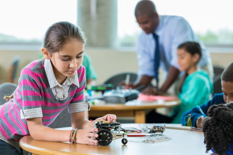 Girl in robotics class