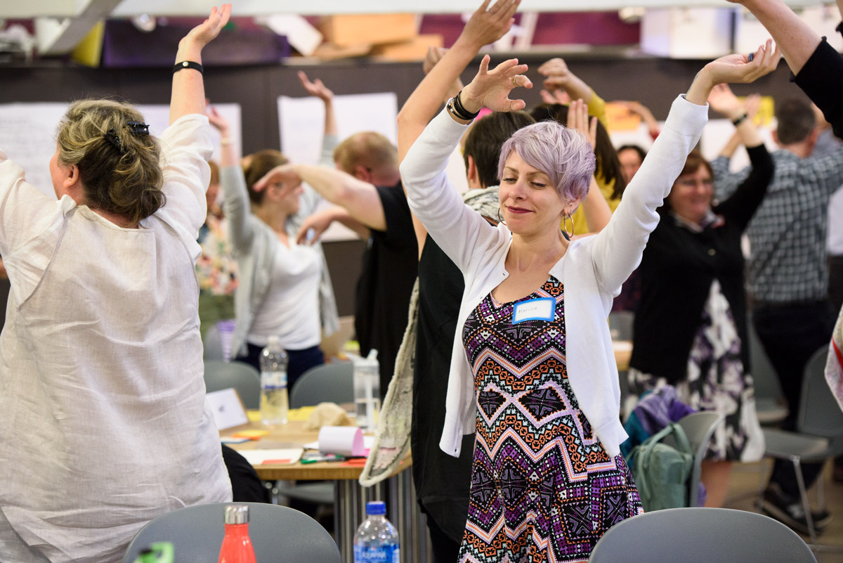 Marisa LoBianco of the New School loosens up with the class between exercises.
