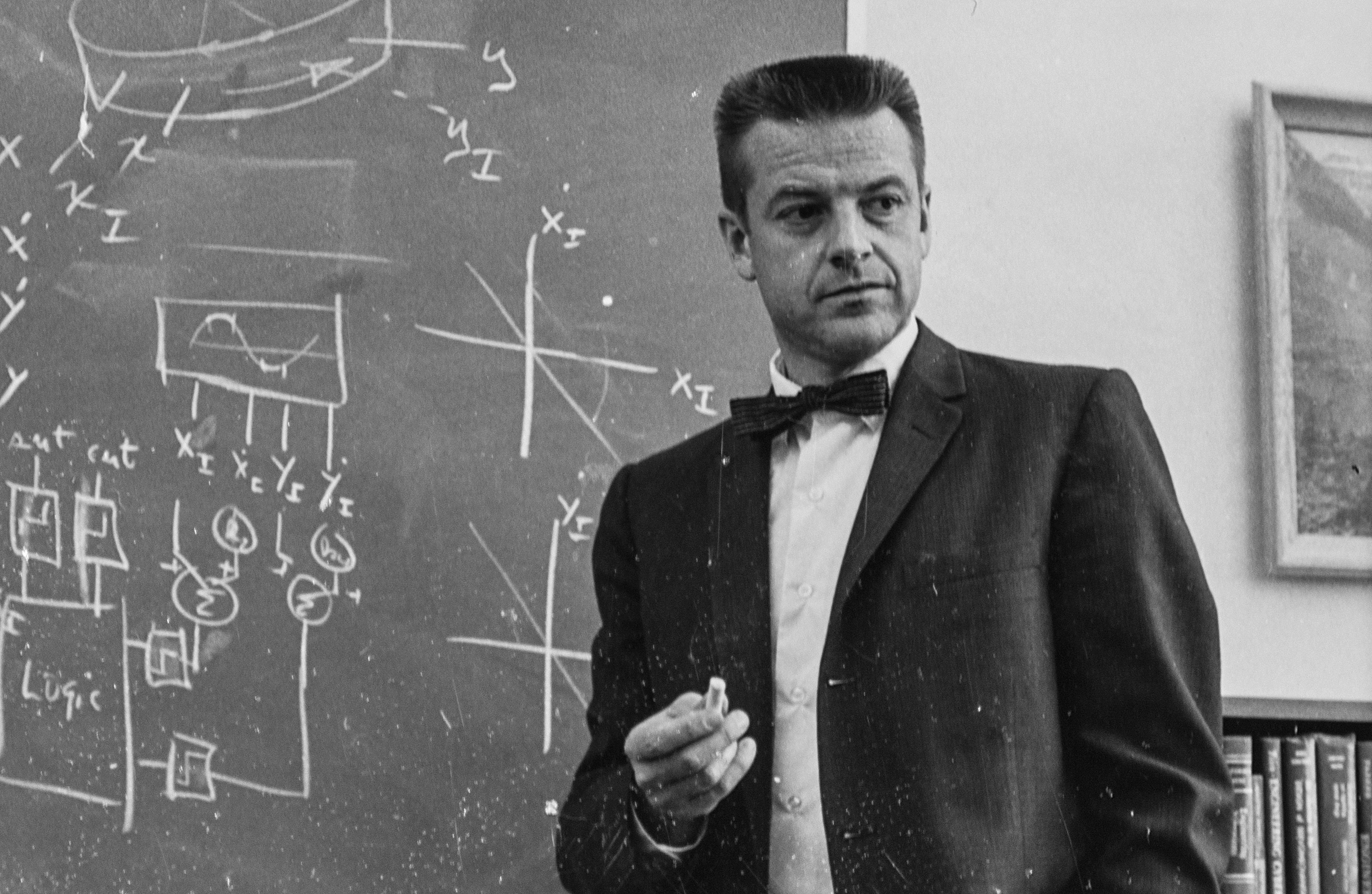 Historic photo of Robert Cannon at chalkboard with mathematical formulas