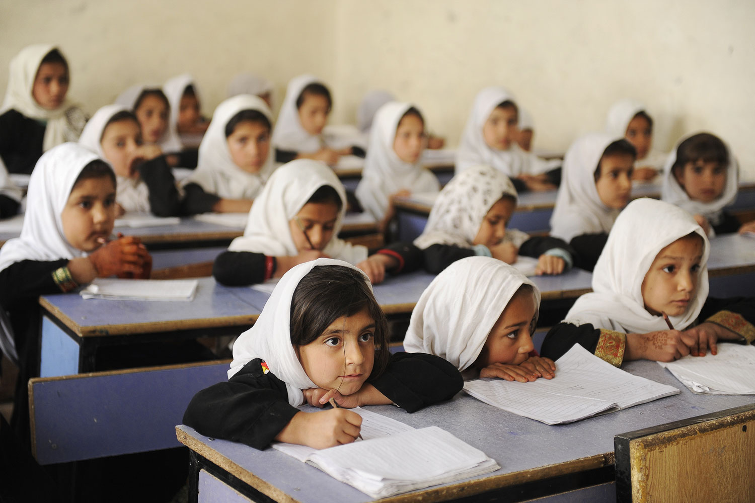 Young girls wearing head scarves attending school in Kandahar, Afghanistan.