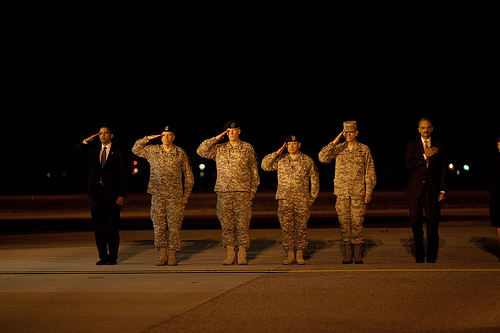 President Barack Obama attends a ceremony at Dover Air Force Base in Dover, Del., Oct. 29, 2009, for the dignified transfer of 18 U.S. personnel who died in Afghanistan. (Official White House Photo by Pete Souza)