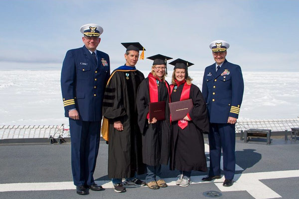 From left, Cmdr. Greg Stanclik, Healy executive officer; Kevin Arrigo, professor of Earth sciences and co-director of the Earth Systems Program; graduating seniors Erin Dillon and Caroline Ferguson, and Capt. John Reeves, Healy commanding officer. (Photo credit: Carolina Nobre)