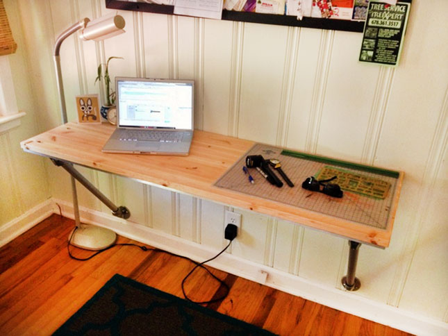 12. Wood and Pipe DIY Desk : Turn a wooden countertop into a desk with