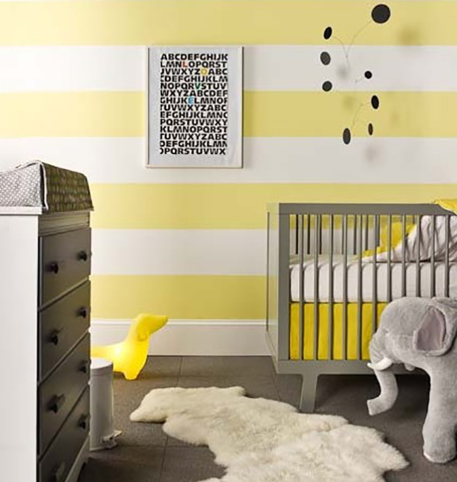 Plush toys and a fur rug make it feel inviting via buy modern baby