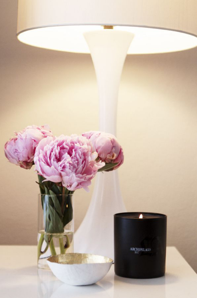 ... Keep a luxurious candle on the bedside table. (via Shop Sweet Things