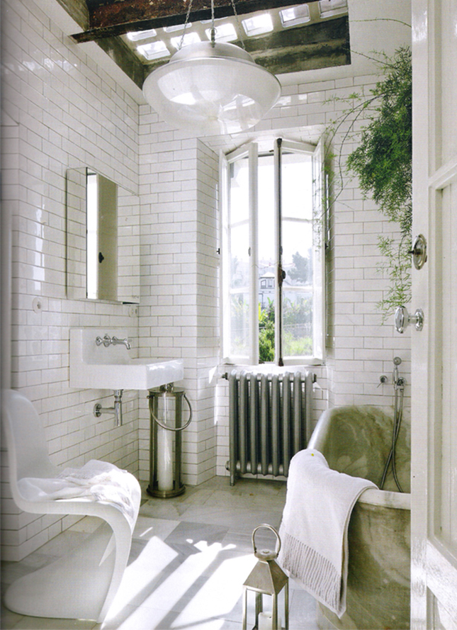 20 bathrooms we wouldn t mind sitting around in brit co for Small bathroom high ceiling