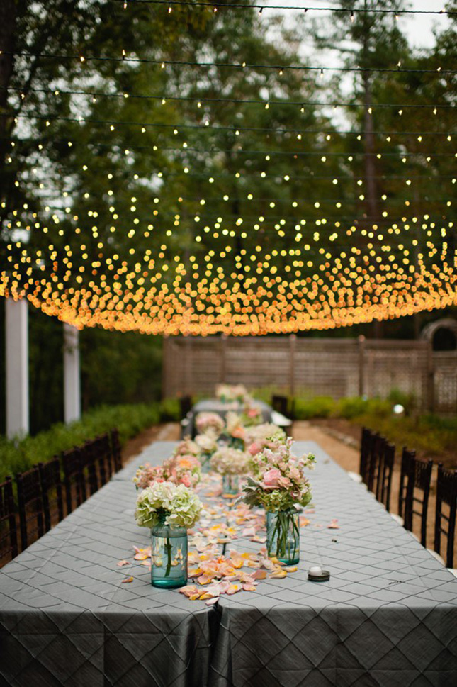 String Lights Under Table : 13 Show-Stopping Long Reception Tables for Your Big Day Brit + Co