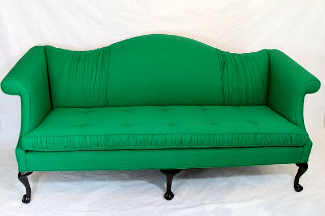 9 bright and colorful couches your living room needs for Amazing bright green sofa