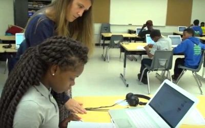 Photo of student and teacher working together at desk