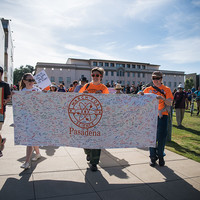 Board members from the Caltech Postdoctoral Association and the Graduate Student Council led marchers from Beckman Lawn to Memorial Park, carrying a banner signed by hundreds of members of the local community to express their support for science.