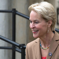 photo of Frances Arnold greeting people at the event