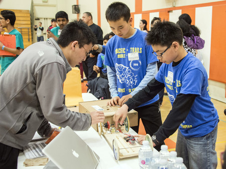 Students from Pacific Trails Middle School check their vehicle in the Battery Buggy event—which challenged teams to build a vehicle that uses electrical energy as its sole means of propulsion in order to quickly travel a specified distance and stop as clo