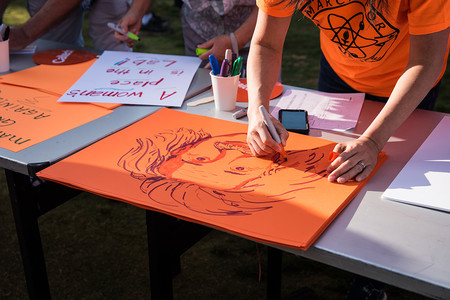 The Caltech Postdoctoral Association provided materials so that participants could make signs