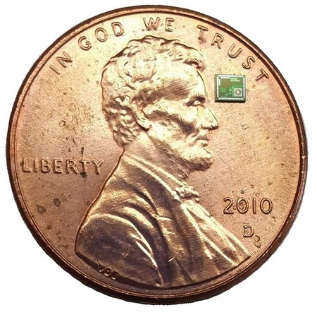 microchip next to a penny