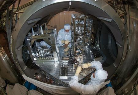 Researchers installing some of the small suspended LIGO mirrors in the vacuum system. - See more at: http://www.caltech.edu/news/dedication-advanced-ligo-46822#sthash.4FtHzbkS.dpuf