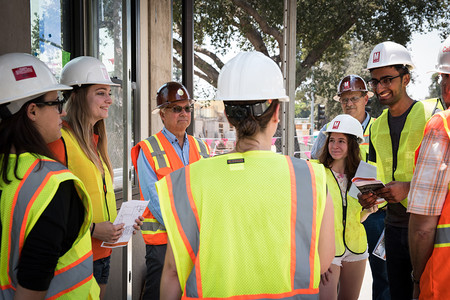 COUCH committee members tour the Bechtel Residence building site.
