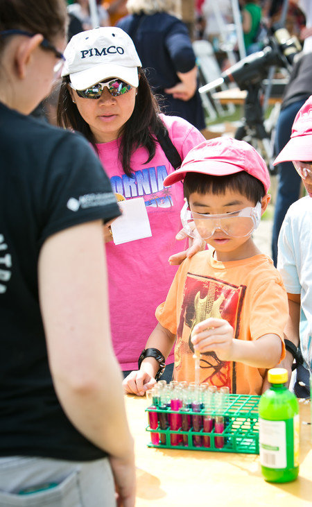 K-12 students, including Ethan Chin, above, got a chance to conduct a wide variety of experiments at the event.