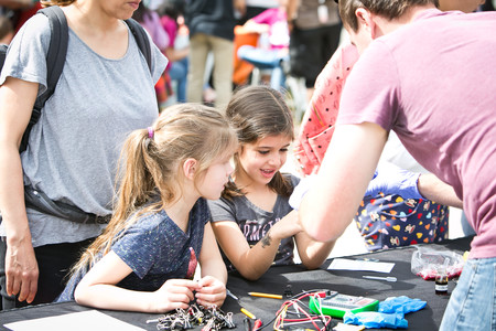 Alexa and Sasha Boronda were among thousands of visitors to participate in hands-on demonstrations and explore educational booths.