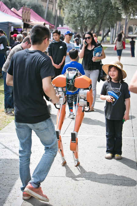 Science for March participant Stella Cook stops to watch a demonstration of Caltech's bipedal robot Cassie at the March 31 event.