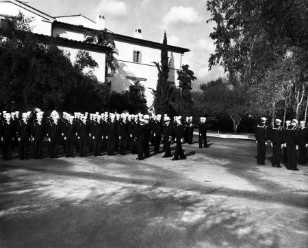Rear Admiral Wilson Brown inspecting V-12 unit at Caltech in 1944